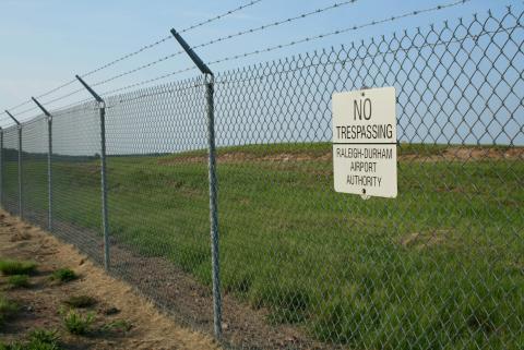 2008-08-01_No_Tresspassing_sign_at_RDU.jpg
