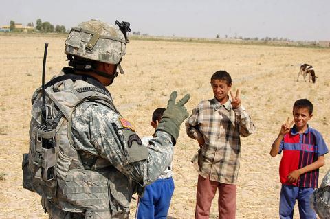 800px-52nd_Infantry_Regiment,_2nd_Stryker_Brigade_Combat_Team_-_Teaches_peace_sign.jpg
