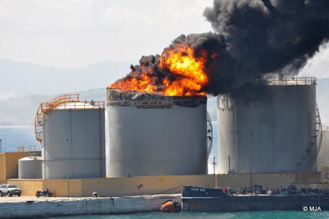 Oil_sullage_tank_burns_after_explosion.jpg