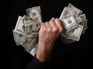 Hand full of bills
