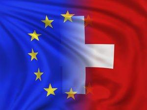 European Union flag and the Swiss flag